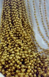 Rideau perlée avec les petites boules d'or
