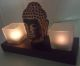 2 candles with Buddah